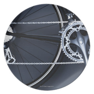 Close up of bicycle chain, pedal and gears dinner plate