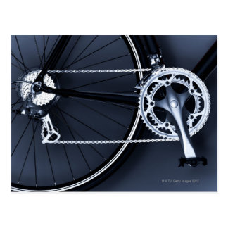 Close up of bicycle chain, pedal and gears post card