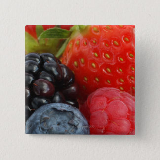 Close-up of blackberry, blueberry and 15 cm square badge