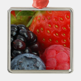 Close-up of blackberry, blueberry and christmas ornament