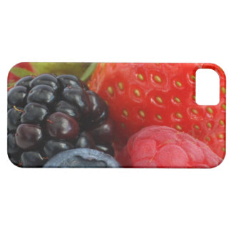 Close-up of blackberry, blueberry and iPhone 5 case