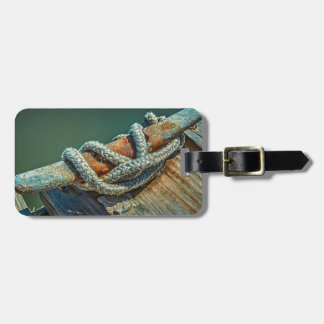 Close-up of boat cleat and rope luggage tag