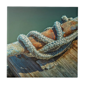Close-up of boat cleat and rope tile