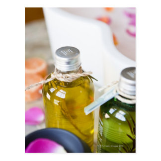 Close up of bottles with massage oils postcard
