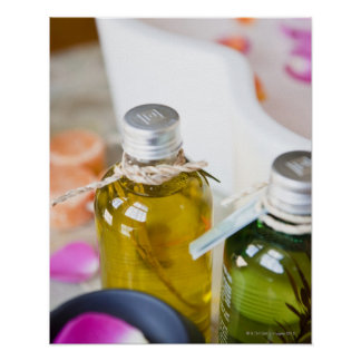 Close up of bottles with massage oils poster