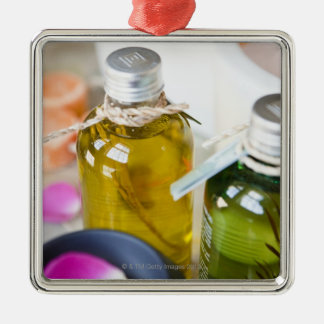 Close up of bottles with massage oils Silver-Colored square decoration