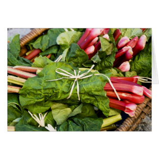 Close-up of bunches of rhubarb in basket card