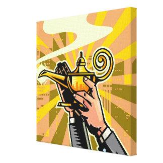 Close-up of businessman holding magic lamp canvas print
