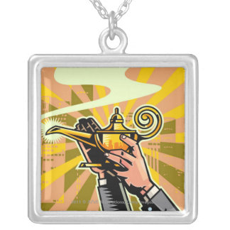 Close-up of businessman holding magic lamp silver plated necklace