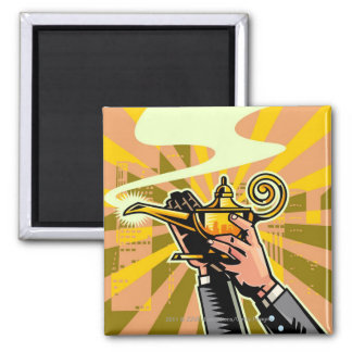 Close-up of businessman holding magic lamp square magnet