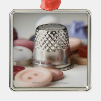Close-up of buttons with a metal cap Silver-Colored square decoration