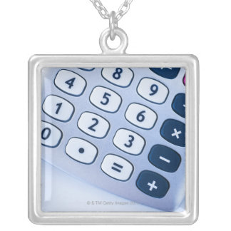 close-up of calculator buttons silver plated necklace