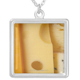 Close-up of cheese slices silver plated necklace
