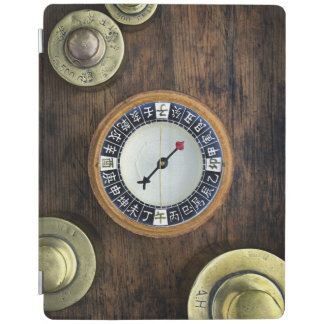 Close Up Of Chinese Compass And Gold Weights iPad Cover