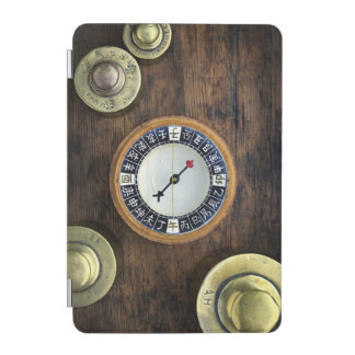 Close Up Of Chinese Compass And Gold Weights iPad Mini Cover