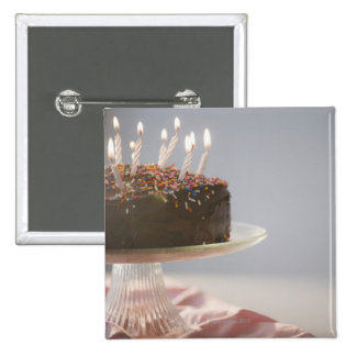 Close up of chocolate birthday cake with candles 15 cm square badge
