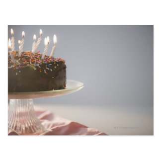 Close up of chocolate birthday cake with candles postcard