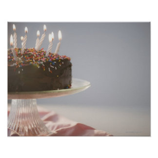 Close up of chocolate birthday cake with candles poster