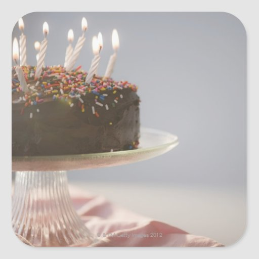 Chocolate Cake Images With Candles : Close up of chocolate birthday cake with candles square ...