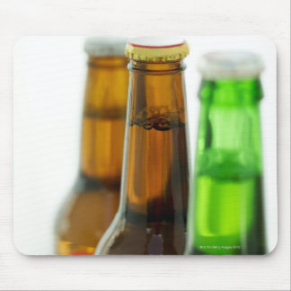 close-up of colored bottles of beer mouse mat
