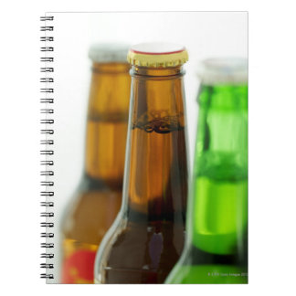 close-up of colored bottles of beer note books
