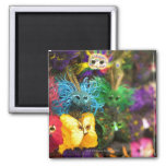 Close-up of colourful miniature masks square magnet