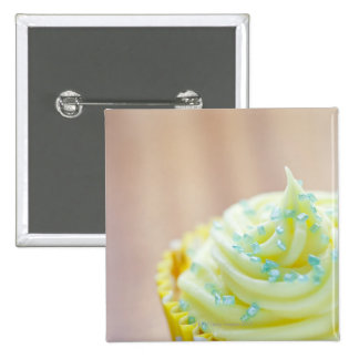 Close up of cup cake showing decoration 15 cm square badge
