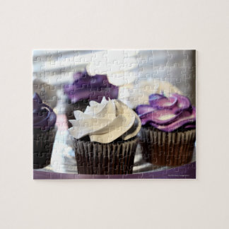 Close-up of cupcakes with selective focus on jigsaw puzzle