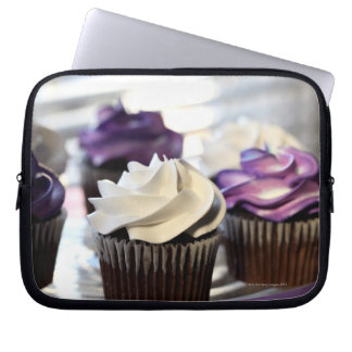Close-up of cupcakes with selective focus on laptop sleeve