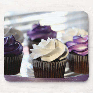 Close-up of cupcakes with selective focus on mouse mat