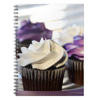 Close-up of cupcakes with selective focus on notebook