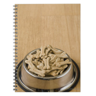 Close-up of dog biscuits in a dog bowl spiral notebook