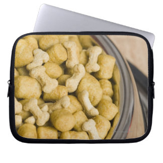Close-up of dog food in a dog bowl laptop sleeve