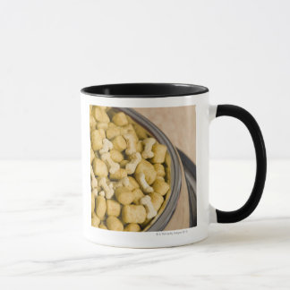 Close-up of dog food in a dog bowl mug