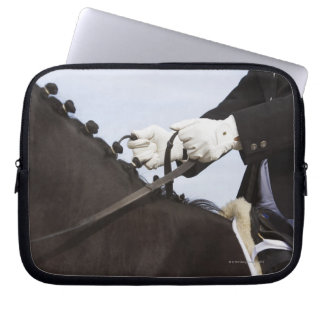 close-up of dressage horse with rider laptop sleeve