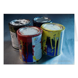 Close-up of four paint cans card
