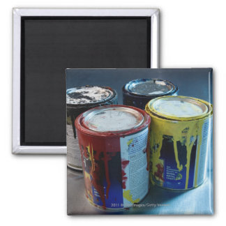 Close-up of four paint cans magnet