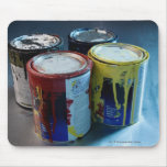 Close-up of four paint cans mouse mat
