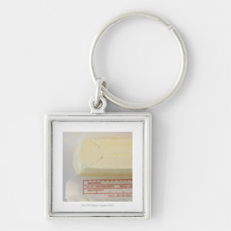 Close-up of fresh butter Silver-Colored square key ring
