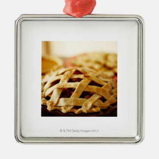 Close-up of fresh pie with lattice pattern crust christmas ornament