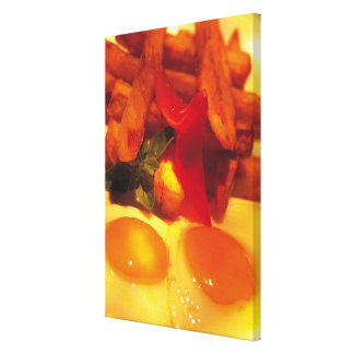 close-up of fried eggs with french fries canvas print