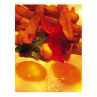 close-up of fried eggs with french fries postcard