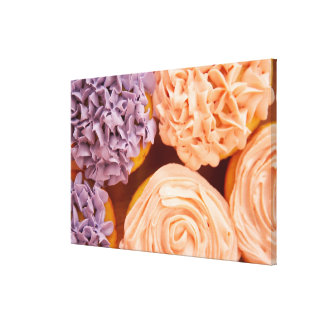 Close-up of frosted cupcakes canvas print