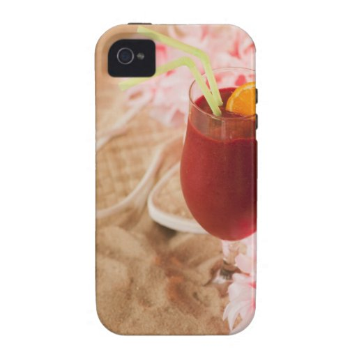 Close up of frozen drink and lei on sand iPhone 4/4S cases