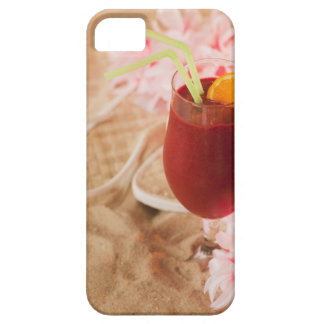 Close up of frozen drink and lei on sand case for the iPhone 5