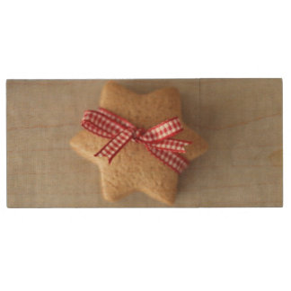 Close up of ginger cookie tied with ribbon wood USB 2.0 flash drive
