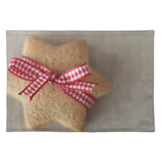 Close up of ginger cookie tied with ribbon placemat