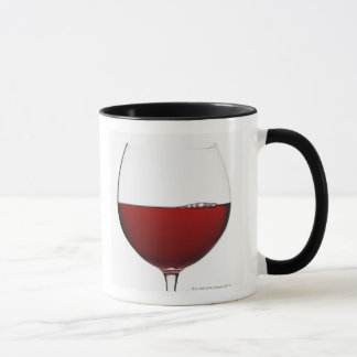 Close up of glass of red wine on white mug