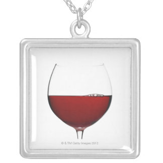 Close up of glass of red wine on white custom jewelry