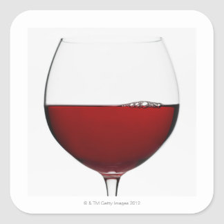 Close up of glass of red wine on white square sticker